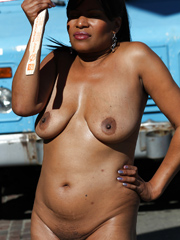 Naked black mature walking in the..