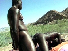 Ebony bitch fucking on a background of mountains
