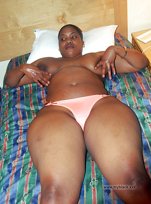 Black slut topless on the bed, I love fat thighs. Full ...